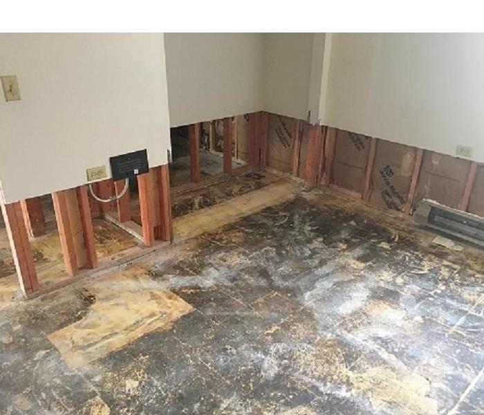 Water damage flood cuts  near the floor  done clean and straight