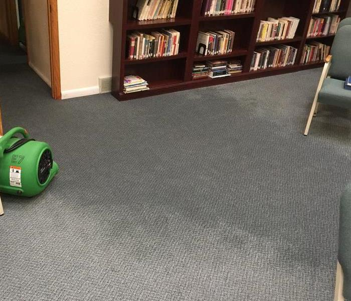 A pipe break at a local business resulted in carpets that needed extracted and drying equipment placed .